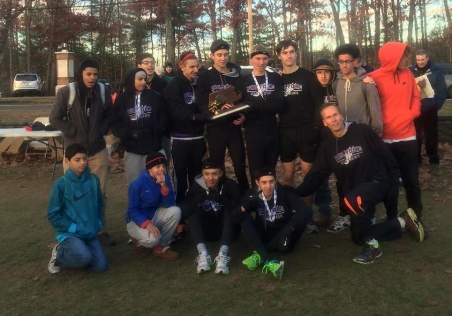 Under the guidance of Coach Reinhart, the HHS Cross Country team won Western Mass this year!