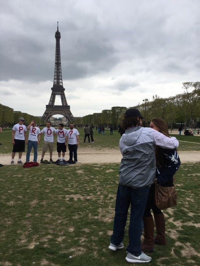 A prom-posal in front of the Eiffel Tower.