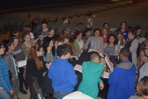 Students read over lines for an upcoming musical.