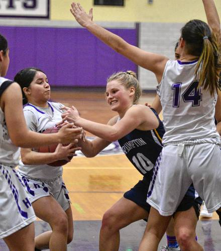 Yamaya Perez, center left, of Holyoke, steals the ball from Amanda Mieczkowski, center right, of Northampton, with Holyoke three points ahead with 28 seconds to play, Thursday, Jan. 16, 2020 at Holyoke High School. Ashley Vazquez, left, and Victoria Lopez look on.